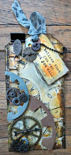 I like it, but a different color pallete would be good. Tim Holtz tags of 2013 by claudette