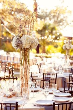 Fresh white and clean centerpieces and dinner tables