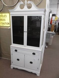 $265 - Shabby chic china cabinet with double glass doors on top - 1 drawer and double door cabinet on bottom - Mahogany interior and painted creamy white & distressed on exterior. A lovely addition to any home. ***** In Booth E6 at Main Street Antique Mall 7260 E Main St (east of Power RD on MAIN STREET) Mesa Az 85207 **** Open 7 days a week 10:00AM-5:30PM **** Call for more information 480 924 1122 **** We Accept cash, debit, VISA, MasterCard or Discover.