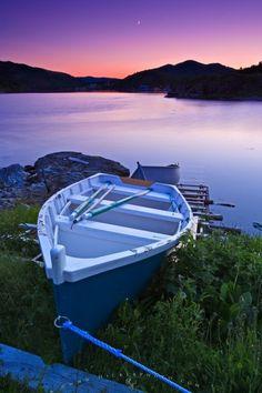 Photo of a wooden fishing boat in Fleur de Lys, Baie Verte Peninsula, Newfoundland.