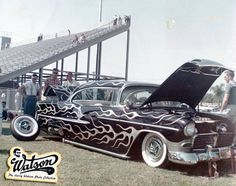 Al Lazarus' 1955 Chevy in its most famous second version. Larry had painted the car super black and covered it was would become known as seaweed flames. Larry's long swirly flames where the first of its kind. They where painted in Olive mist green metallic tipped in silver and pinstriped in imitation gold.
