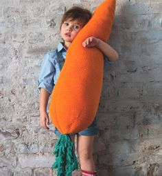 Knitted oversized carrot pillow