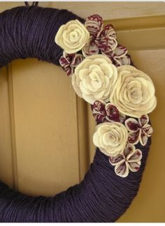 Yarn and fabric flowers make this a perfect wreath for any holiday.
