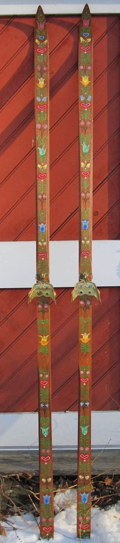 hand painted vintage cross country skis with folkloric flowers