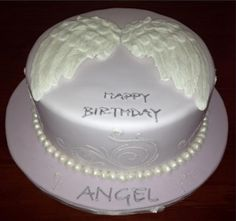 White and dark chocolate marbled mud cake. Covered in lavender fondant with hand made gum paste angel wings, stenciling around cake and fondant pearls. Angel Theme, Giraffe Cakes, Birthday Angel, 4th Birthday, Birthday Cakes, Birthday In Heaven, Butterfly Cakes, Mud Cake, Angel Cake