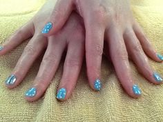 CND Shellac polka dots with a mirrored foil accent by Jill G.