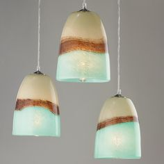 Earth, sea and clouds seem to unite in this brown, aqua, and cream art glass pendant light. Its breathtaking beauty is not fully realized until lit! Since this glass is hand blown glass, every pendant Glass Art, Glass Lamp, Glass Blowing, Pendant Light Shades, Sea Glass Pendant, Light, Glass Shade Pendant Light, Blown Glass Pendant, Glass Lighting