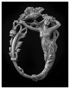 An art nouveau copper stamping of a nymph with flowers, leaves and thistle.