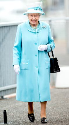 2014 Queen Elizabeth II paid a visit to the Portsmouth Naval Base in a bright blue confection