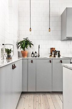 gray kitchen cabinets with leather pulls. / sfgirlbybay