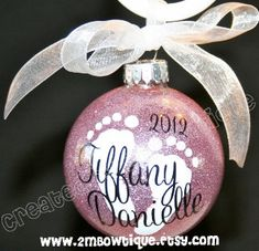 Baby's First Christmas Glitter Ornament, Glass. $14.00, via Etsy.