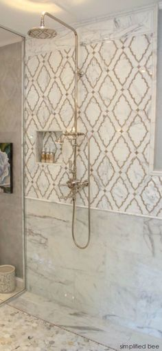 What is the Hottest Decorating Trend 2015 That Is Never Going to Go Away? - laurel home | simplified bee | cool marble shower with antique brass and gold accents