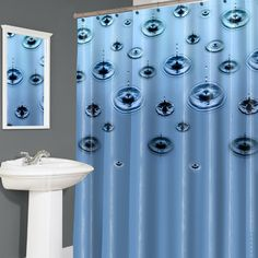 """Trickle Eva Vinyl Shower Curtain Add splashy fun to your bathroom with the Trickle shower curtain a design of drips and rings on a field of blue.  70Lx72W"""".  In easy care 100 EVA.  Wipe Clean With A Damp Cloth"""