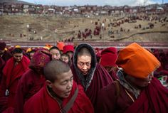 SERTAR, CHINA - OCTOBER 30: Tibetan Buddhist nuns stand following a chanting session as part of the annual Bliss Dharma Assembly at the Larung Wuming Buddhist Institute on October 30, 2015 in Sertar county, in the remote Garze Tibetan Autonomous Prefecture, Sichuan province, China. The last of four annual assemblies, the week long annual gathering takes place in the ninth month of the Tibetan calendar and marks Buddha's descent from the heavens. Located high in the mountains of Sichuan, the…