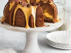 Apple-Cream Cheese Bundt Cake | This delicious apple bundt cake features a sweet cream cheese filling and homemade praline frosting. Garnish the frosting with extra toasted pecans.