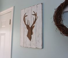 white distressed deer silhouette - something like this for jimmy's mancave space.