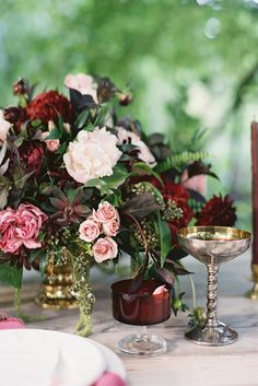 Rich marsala flowers paired with lighter blooms and dark, wine tinged greens look stunning in vintage silverplate or paired with ruby depression glass