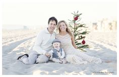 Family Celebrating the Holidays on the Beach. Photography / Smile / Play / Natural / Lifestyle / Ocean / Outdoors / Fun / Happy / Mom / Nature / Water / Family Portrait Session / Photo Shoot / Dress / Long Beach / Child / Baby / Sand / California / Christmas Tree / Hat www.blossombluephotography.com