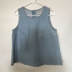 Madewell Raw-Edged Cut-Out Denim Tank Top Worn once, a little tight across the bust. Super cute. Best suited for a medium in my opinion but is a size large. Madewell Tops Tank Tops