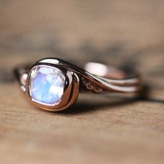 Rose gold moonstone ring, Rainbow moonstone ring gold, rose gold engagement ring, moonstone engagement ring, 14k gold Pirouette, custom made by StephanieMaslow on Etsy https://www.etsy.com/listing/260544073/rose-gold-moonstone-ring-rainbow