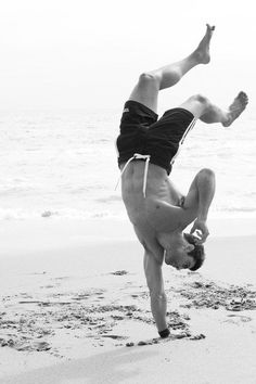 Tyler Hoechlin on the beach.  Few clothes. Handstand. I can't form coherent sentence...