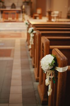 I like the way they did the ribbons - good to note since our church requires ribbons for flowers on the pews