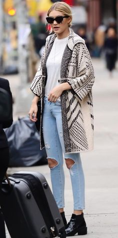 Gigi Hadid gave her white tee and light distressed jeans a playful spin with a statement-making oversized jacquard Tory Burch coat, complete with tortoiseshell sunnies and black ankle boots.