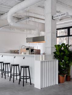 Asketik creates stark white coffee shop in Soviet silk factory