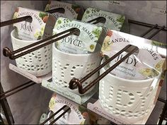 Upswept Tips can come on more than one-up Loop Hooks. Here Multiple Loop Hooks are spaced for permanent Point-of-Purchase display of custom name ceramics, backlit by candles.