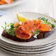 Smoked salmon on a toasted cracker with garnish. A great dish for an appetizer for a chic baby shower.