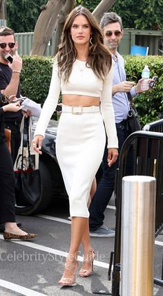 Super model, Alessandra Ambrosio dazzled Los Angeles in this white crop knit sweater and knit pencil skirt. Her heeled sandals added that little extra sexiness to the 'barely there', minimalist vibe, creating an all around glamorous look.