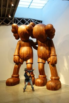 ON-THE-GO: PHARRELL WILLIAMS stopped by the Mary Boone Gallery recently in New York to check out KAW's new sculptures. Awesome! #rozoO... Kaws Figurine, Museum Of Modern Art, Art Museum, Pharrell Williams, Vinyl Toys, Wood Sculpture, All Art, Wood Art, Style Icons