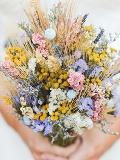 Rustic wildflower wedding bouquet with dried wheat