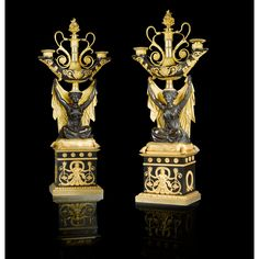 A FINE PAIR OF PATINATED AND GILTBRONZE CANDELABRAS, EMPIRE