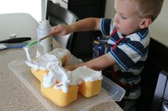 Use shaving cream with sponges and spatulas for fine motor control; spreading, smearing, and layering, as well as a way to teach math concepts.