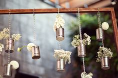 Hanging tin can DIY vintage white flowers from wood frame outdoor wedding party