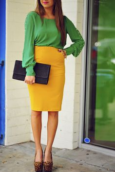 She is a working girl, yellow pencil skirt with a green blouse and animal print pumps. Super cute