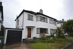 Not just an art deco semi, this is a rather impressive renovated three-bedroom art deco property in Gidea Park, Romford, Essex. The current owner Art Nouveau, Architecture Cool, Exterior Front Doors, Exterior Paint, Gothic, House Windows, Bay Windows, Front Windows, Streamline Moderne