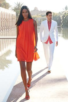 The color we're crushing on this summer—orange. Make it a monochromatic look with an oh-so-chic trapeze dress and sky-high sandals. And don't forget your guy. Perk up his go-to white, summer suit with a burst of this fun-loving hue. #INCStyle