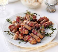 Sticky Sausage and Rosemary Skewers - Our version of pigs in blankets uses a decorative herb sprig and a drizzle of sweet maple syrup to really bring the traditional side dish to life Bbc Good Food Recipes, Healthy Recipes, Healthy Food, Sticky Sausages, Cocktail Sausages, Christmas Trimmings, Sticky Chicken, Pigs In A Blanket, Sunday Roast