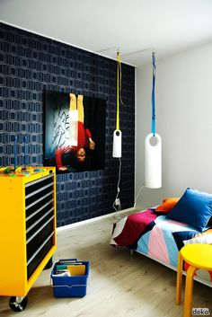 Add a unique artistic light to this room from Dianoche Designs: http://www.dianochedesigns.com/yoda/  the boo and the boy: eclectic kids' rooms