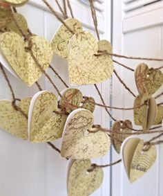 This paper heart garland is approx 5 feet long, each heart is hand punched and is approx. 2 inches in size. This garland is made from high quality paper. Each set of hearts has three total, one white, and two are beautifully printed with vintage flowers and designs, in neutral colors, these are perfect for birthdays and room decor, weddings, anniversaries, valentines, summer parties, or whatever else you can imagine!! Each garland is made from polished spun hemp and has a small amount at…