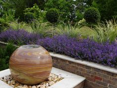 Contemporary Sloping Garden - Andrea Newill Garden Design Sphere Water Feature, Limestone Paving, Cottage Patio, Aluminum Pergola, Contemporary Garden Design, Sloped Garden, Raised Beds, Detached House, Water Features
