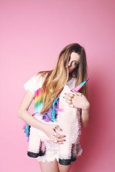 unicorn pinata and a rainbow shirt