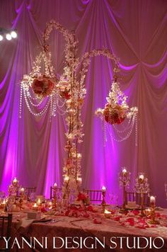 yanni design studio | chandelier centerpieces with candles and flowers, prefect flower ...