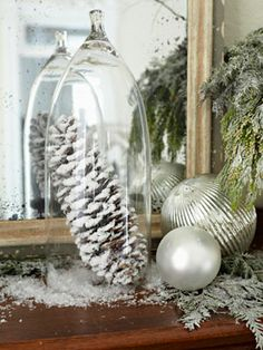 "Frosted pine cone---I have gigantic pine cones from travels. Perfect centerpiece idea...silver ornaments, bell jar, and ""frosted"" pine cone"