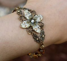 Flower Bracelet  ivory flower with topaz czech glass beads, topaz swarovski crystals, and antiqued brass findings