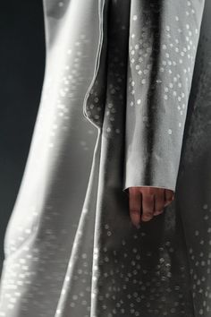 Grey coat with micro geometric embroidery in a scattered pattern; sewing; close up fashion detail // Matohu Fall 2013