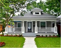 Wrap around porch :) love this house! Maybe I would make stair case wider and add French doors :)