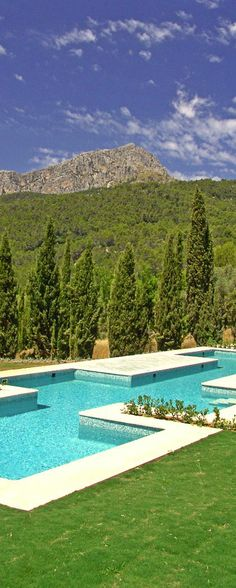 Poolside lounging in the rugged Tramuntana Mountains, Spain